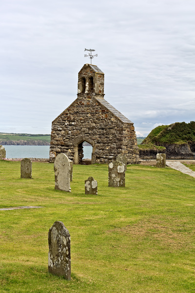 Church ruins: Remains of a church and graveyard by the coast in Pembrokeshire, Wales.