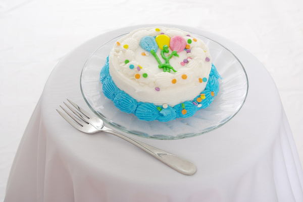 Birthday Cake: A small decorated birthday cake