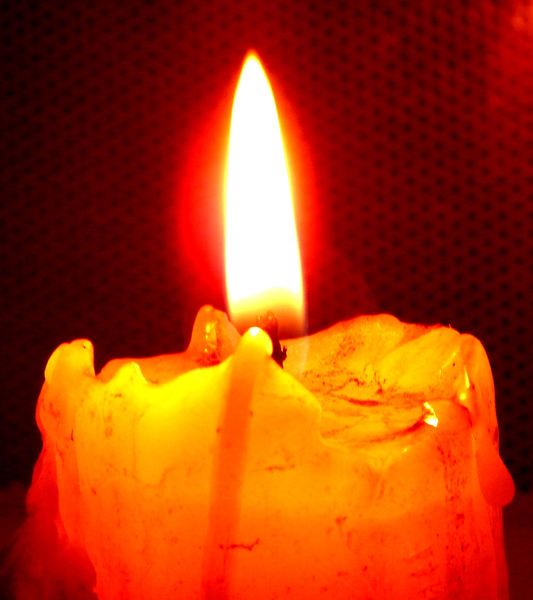 candleglow in the dark1: brightly burning Christmas candles with mesh background