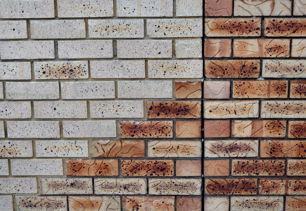 solid merger3: mixed bricks colours, textures and variations in same single modern brick wall