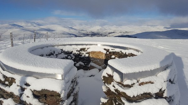 Winter mountain viewpoint: Circular wind shelter/viewpoint on the peak of Mount Blair in the southern Cairngorms, looking up Glen Shee.