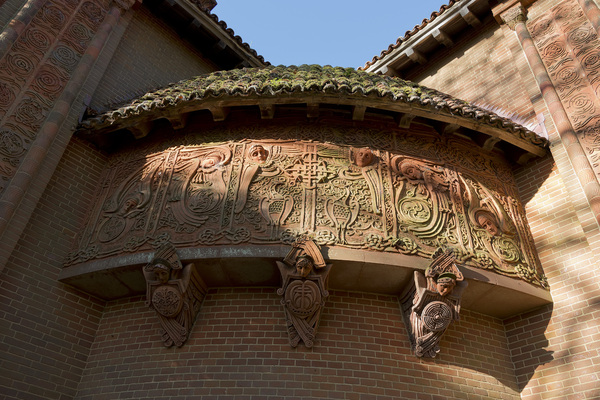 Terracotta church decorations: Terracotta decorative artwork on a church in Surrey, England. Photography of the exterior of this building was freely permitted.
