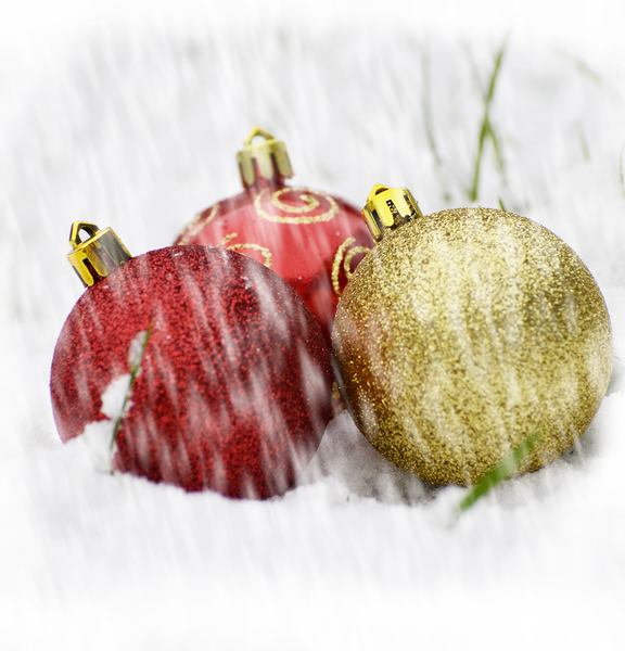 Baubles in snow: baubles in snowy grass