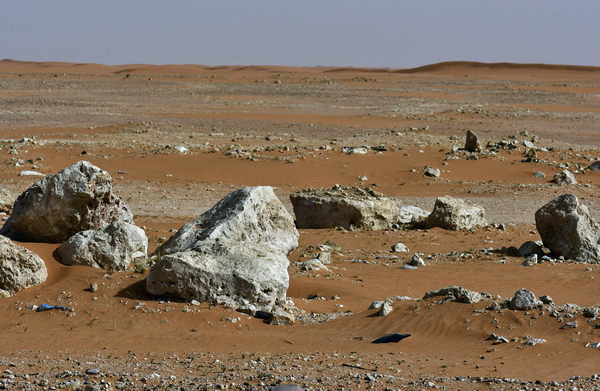 Rocks found in the desert: Desert landscape in red sand and some rocks found . This is in the heart of Saudi Arabian desert.