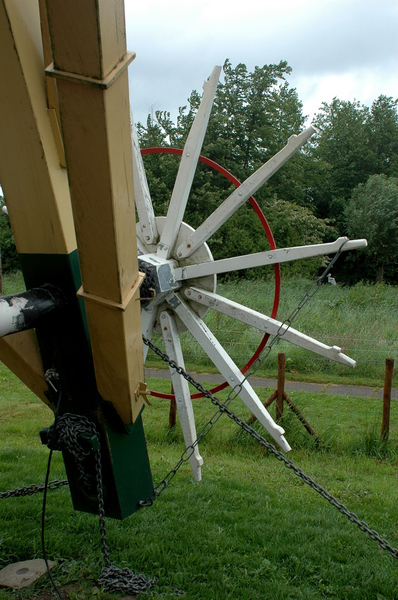 Wheel of a windmill: Wheel of a windmill used to turn the sails into (or out of) the wind.