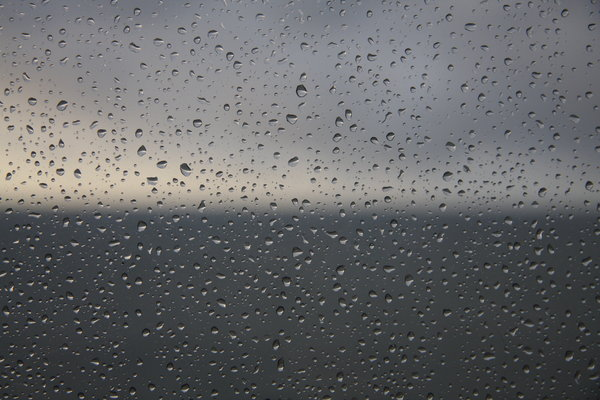 Window: Window to the ocean in a hard rain day