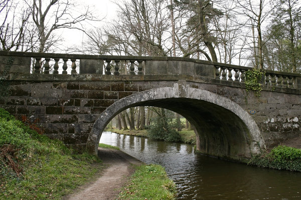 Stone bridge 2: An old stone bridge over a canal in England in early spring.