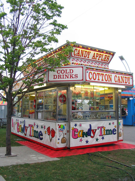 Cotton Candy Stand: At the CNE (Canadian National Exhibition) in Toronto.  http://www.theex.comPlease let me know if you are able to use my pictures for something.Even if it's something small --I would be absolutely thrilled to know if they came in useful for anyone!
