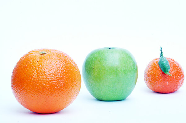 Orange apple mandarin.: Three kind of fruits ...