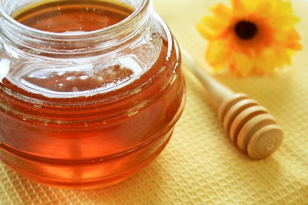 Honey Jar: Glass honey jar with wooden honey spoon