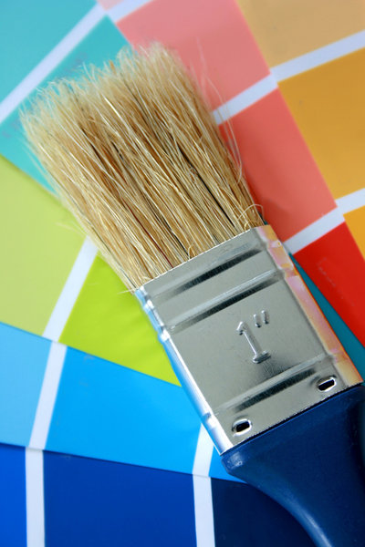 Paint Brush: Blue handled paint brush against a colour chart
