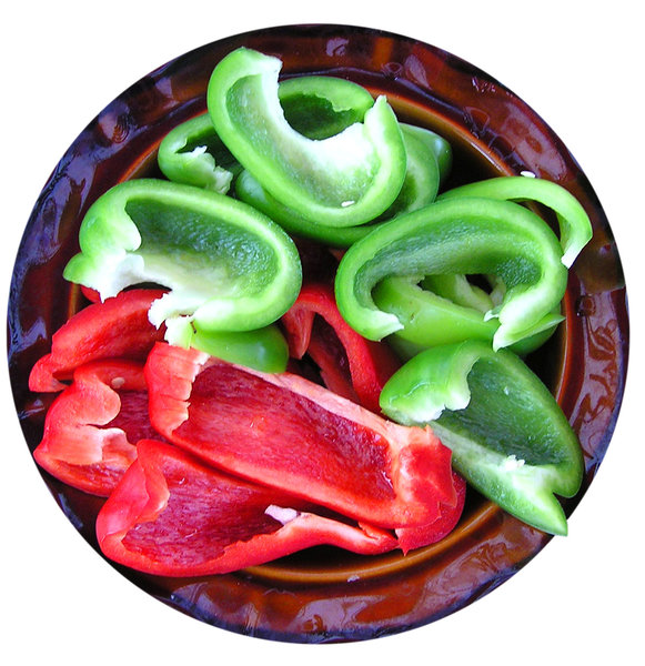 Red and green pepper: Red and green pepper on a plate.Please mail me if you found it useful. Just to let me know!I would be extremely happy to see the final work even if you think it is nothing special! For me it is (and for my portfolio)!