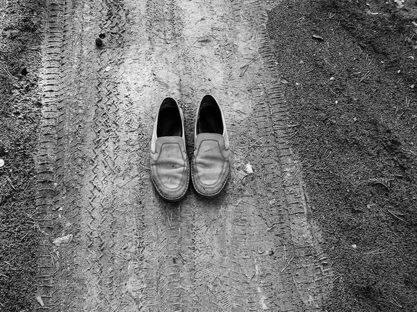 Traces / Old shoes on the path: Old shoes on the sandy path, B&W photo.Please mail me or comment this photo if you decide to use it. Thanks.I would be extremely happy to see the final work even if you think it is nothing special! For me it is (and for my portfolio)!