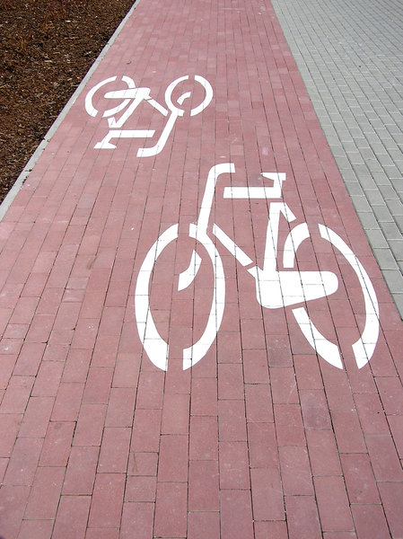 Bicycle path: A pavement brick path made for bicycles only.Please comment this shot or mail me if you found it useful. Just to let me know!I would be extremely happy to see the final work even if you think it is nothing special! For me it is (and for my portfolio)!