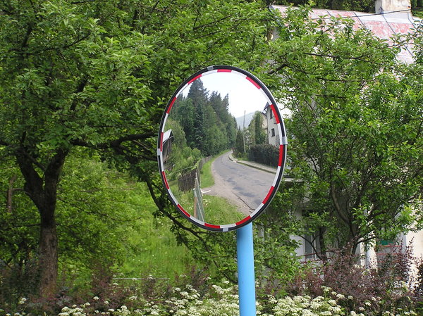 Road mirror: A road sign - mirror. It helps drivers to see what is behind the corner.Please comment this shot or mail me if you found it useful. Just to let me know!I would be extremely happy to see the final work even if you think it is nothing special! For me it is 