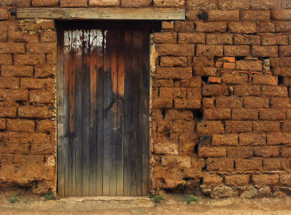 Old Wooden door: Old wooden door in an adobe made house.
