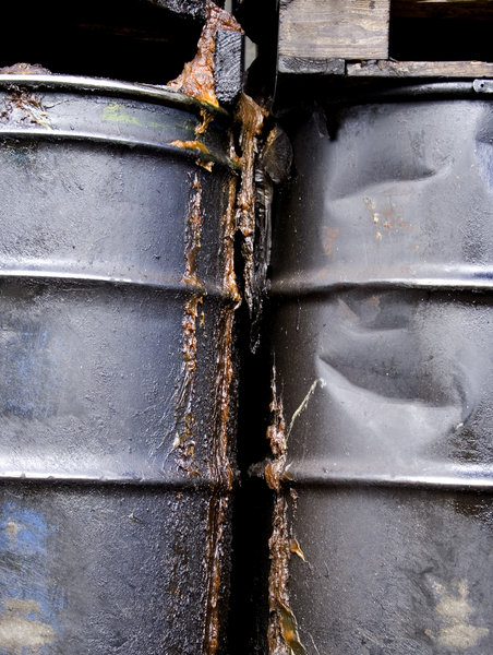 Oil Drums 3: Some battered and leaking oil drums on a trailer.  Pollution theme.