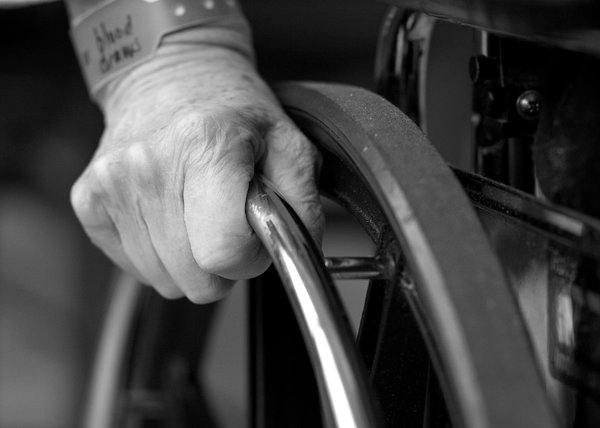 Wheelchair: Closeup of hand on wheelchair.