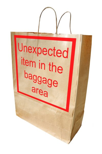 Unexpected Item: Brown paper shopping bag with the reproduced supermarket automated self service error message (familiar in the UK) Unexpected item in the baggage area