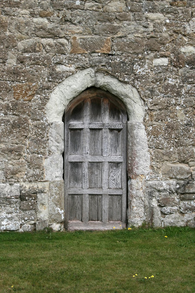 Old door: Old wooden door in an historic house in Kent, England.