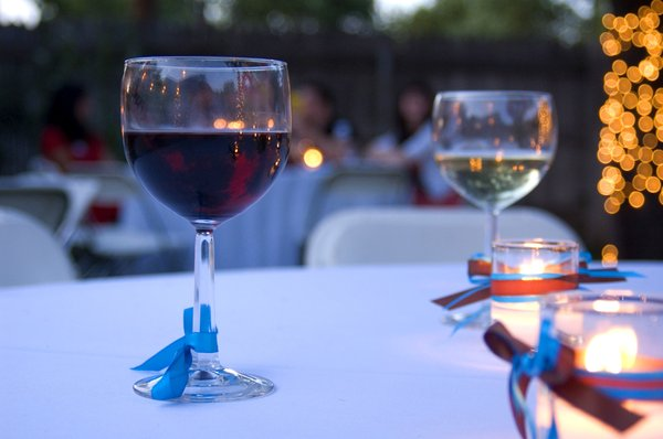Wine at Twilight: Wine glasses left behind at a wedding reception at dusk.