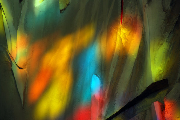 Rainbow in the church 3: Sunrays coloured by stained glass on the church wall