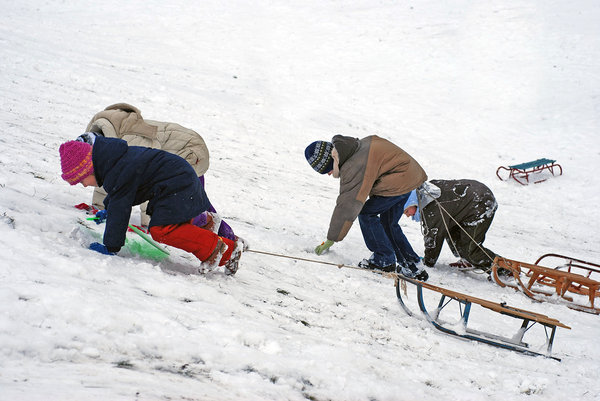 Children playing with sled 2: Winter plays of the kids