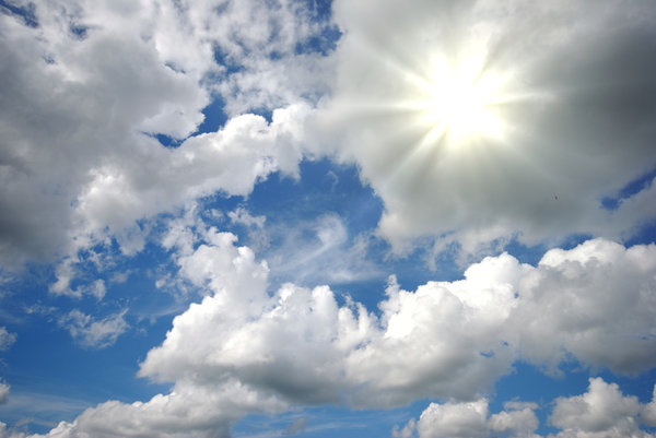 Sun over the clouds: Wide sky with clouds and sunrays