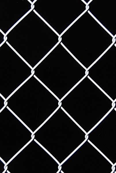 Wire netting texture 3: Netting fence on black background pattern
