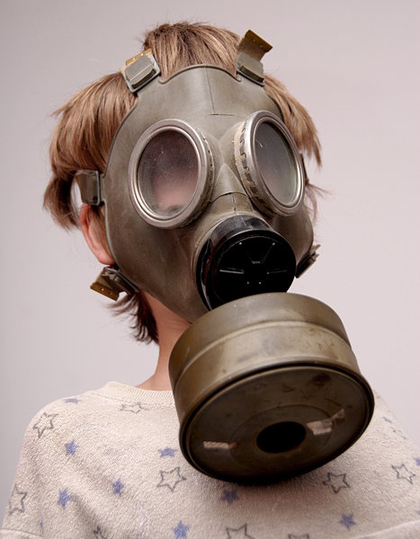Boy in the soviet gas mask  2: Mask worn over the face to protect the wearer from inhaling airborne pollutants and toxic materials