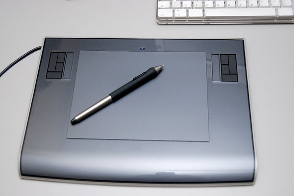 Graphics tablet  1: Digitizing tablet is a computer input device that allows one to hand-draw images and graphics, similar to the way one draws images with a pencil and paper.