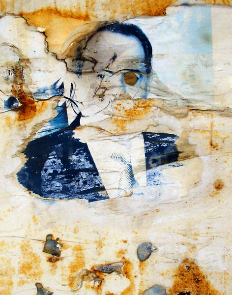 Say hello to the president: A torn poster of the president, with one eye gouged out...
