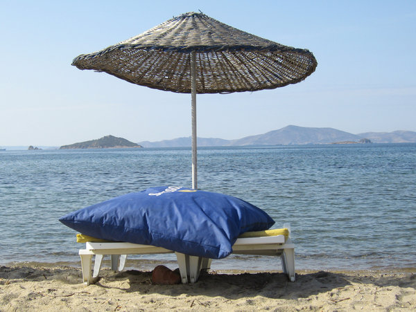 Turkish shade: Turgutreis beach in Turkey on a very hot day