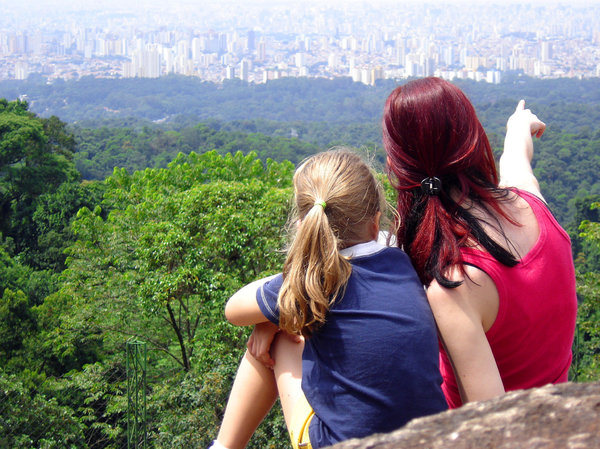 Looking at beyond 2: Two girls looking to São Paulo city from Pedra Branca, SP, Brasil