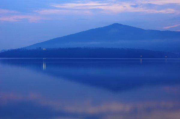 Lake at dusk: Mountain reflected on lake at dusk