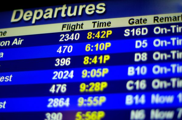 Timetable at the airport...: A timetable display at the Seattle/Tacoma airport.