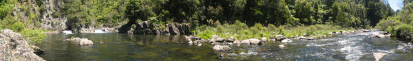 River Panorama: The Karangahake Gorge in New Zealand - waterfall and water hole close to an old gold mining point.