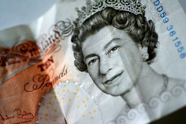 The Queen: Macro shot of the queen on a £10 note.