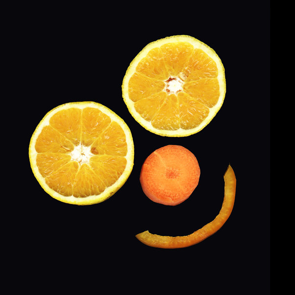 vege & fruit smile: orange eyes, carrot for nose and pepper mouth