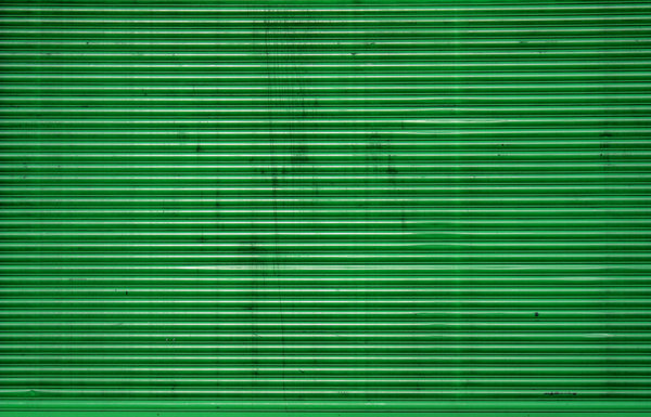 green corrugated iron: Green corrugated iron texture from rolling door.