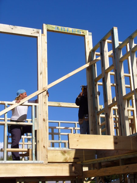House framing with builders: Couple of builders on house frame.