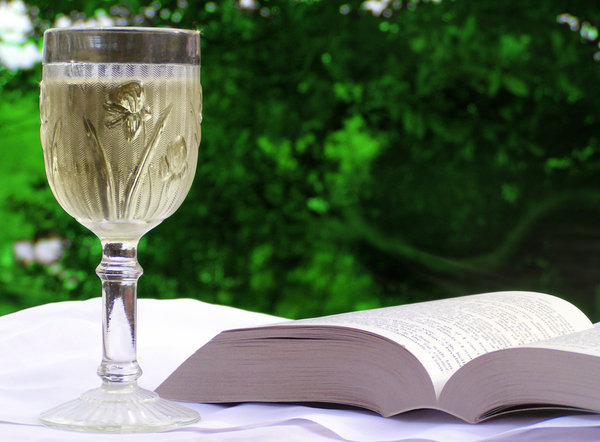 Glass of wine with book: Nothing like having a good read with a glass of wine in hand