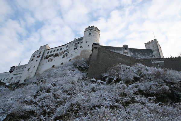Winter castle: The ramparts of Salzburg castle in December snow.