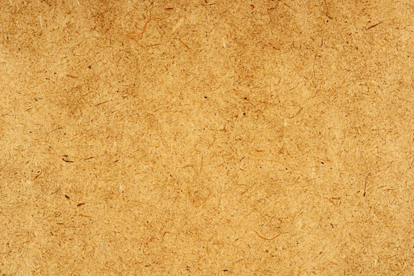 Fiber Texture: The close-up texture of a fibrous composition board used as a construction material.