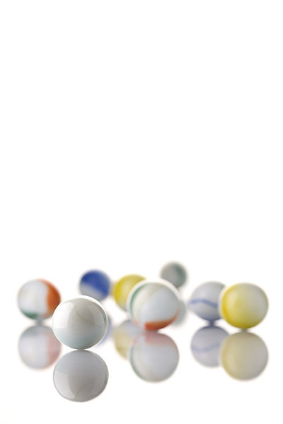 White Toy Marbles: White marbles on a white background