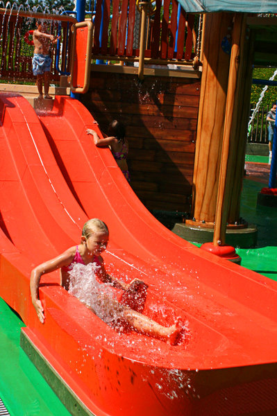 summer fun: kids playing at a theme park...