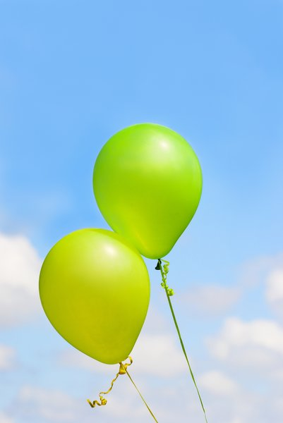 Balloons in blue sky: Two festive balloons in a bright sky