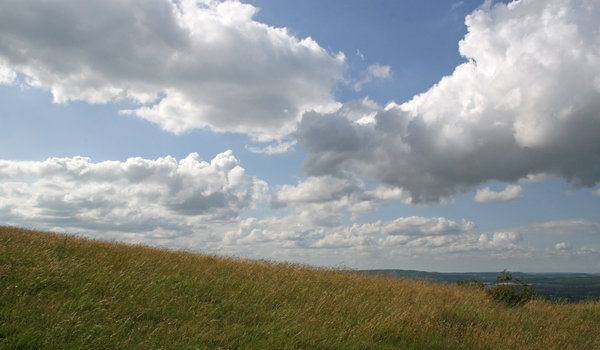 Meeting of clouds: Cloud formations on the South Downs, England, in summer.