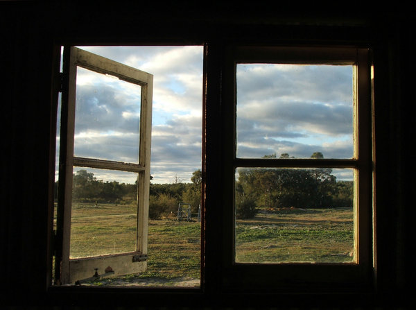 through the windows: windows framing outside farmyard and garden