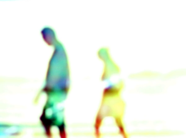 Couple Walking on the Beach: Hazy figures on a hot, sunny day at the beach. You may prefer:  http://www.rgbstock.com/photo/2dyVUnr/Oz+Christmas  or  http://www.rgbstock.com/photo/o1yAQRg/Quiet+Walk+on+the+Beach